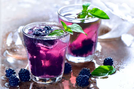 Bramble or blackberry cool summer drink or alcoholic coctail