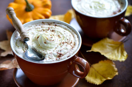 Pumpkin spice latte, traditional autumn warm cozy drink