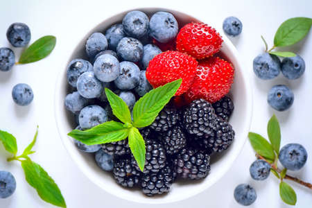 Various summer berries in a bowl