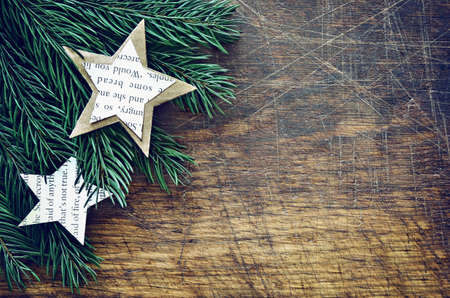 firry: Christmas retro background with firry branches decorated with handmade paper decorations, stylized image Stock Photo
