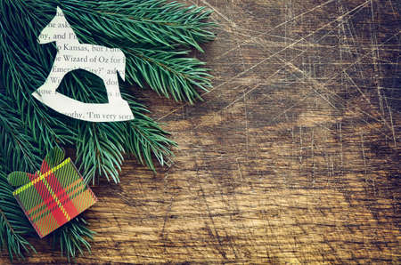firry: Christmas retro background with firry branches decorated with handmade decorations, stylized image