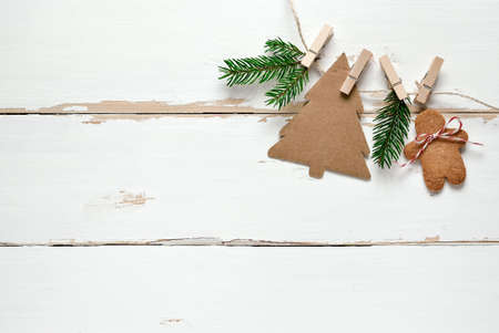 top of the year: Rustic wooden background decorated with simple handmade decorations and gingerbread Stock Photo