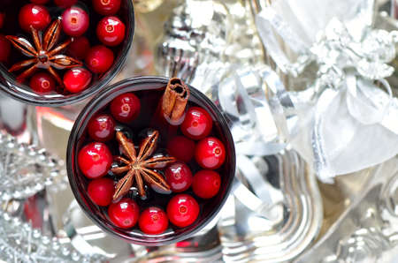 alcohol drinks: Cristmas traditional warm alcohol drink or cocktail with spices and cranberries surrounded with sparkling decorations