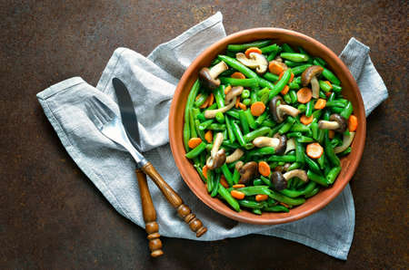 vegan food: Warm green bean, carrot and mushroom salad, view from above