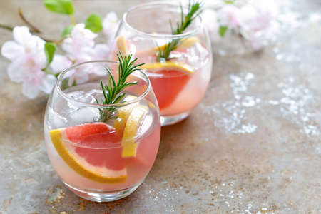fizz: Grapefruit and rosemary drink, alcohol or non-alcohol cocktail or infused water with ice