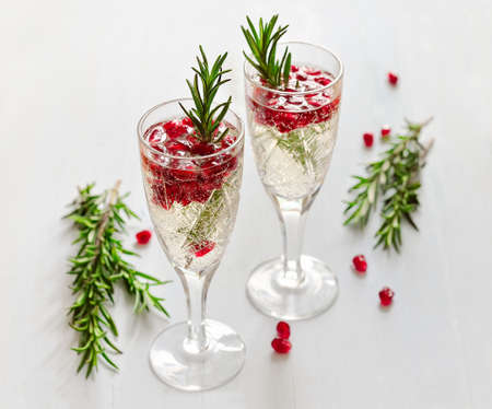 champagne pop: Fizz with pomegranate seeds and rosemary
