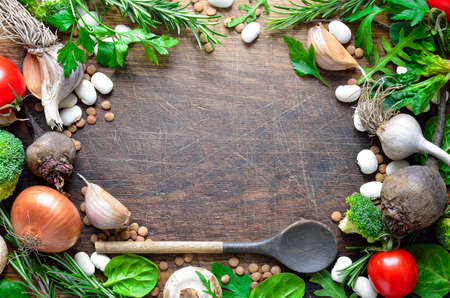 Culinary wooden background with fresh farm vegetables Stock Photo