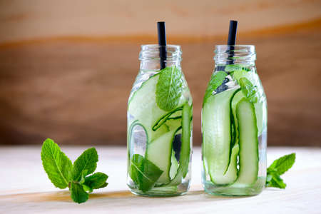 flavoured: Cucumber and mint infused water in two bottles Stock Photo