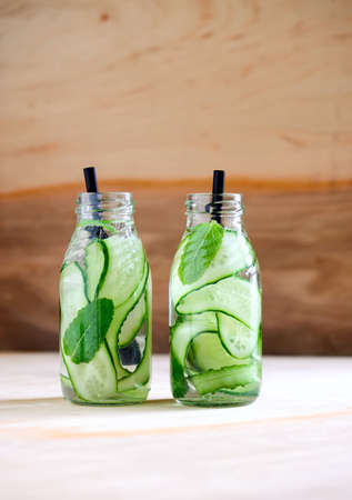low calories: Cucumber and mint infused water in two bottles Stock Photo