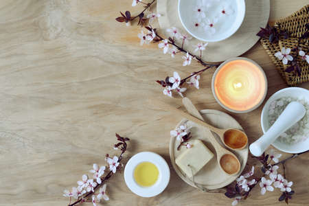 Spa setting with spring blooming branches and burning candle