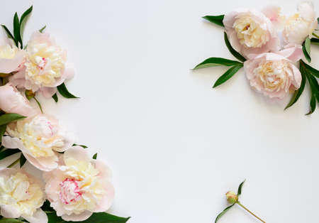 Wedding invitation or Mother's Day  background, empty space surrounded with flowers, top view
