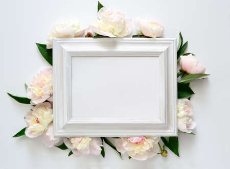 Wedding invitation or bridal shower invitation, white wooden frame decorated with flowers, blank space for a text