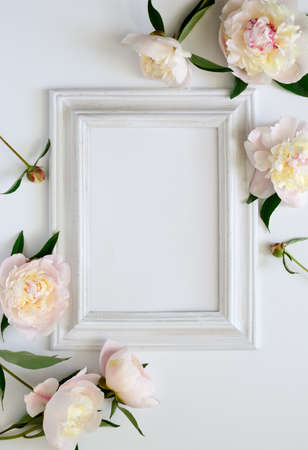 Wedding invitation or bridal shower invitation or Mothers Day card mockup, white wooden frame decorated with flowers, blank space for a text