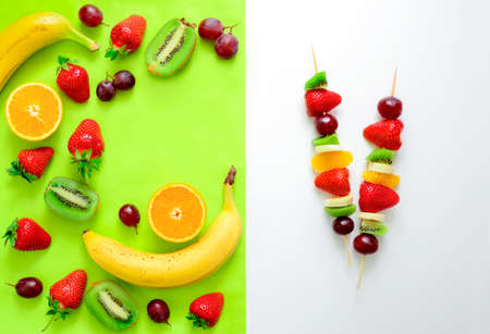 simple meal: Fruit and berry skewers concept, simple healthy raw meal and ingredients, top view