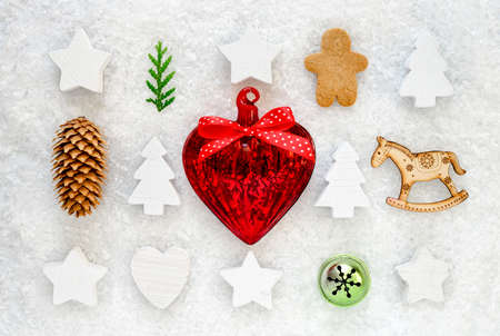 Christmas decorative staff collection on a snow background, flat lay, view from above Stock Photo