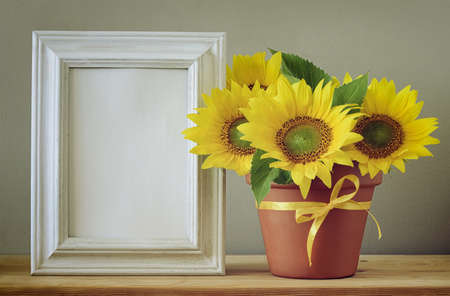 pots: Autum greeting card with space in a frame for a text, setting with sunflowers bouquet, retro stylized photo