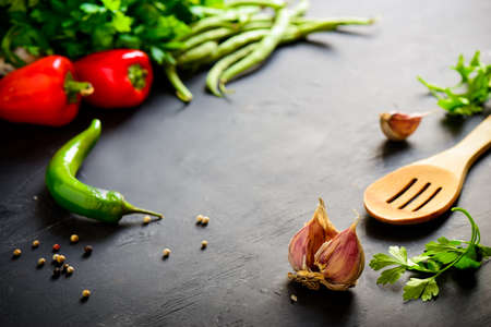 kulinarne: Dark table with culinary ingredients Zdjęcie Seryjne