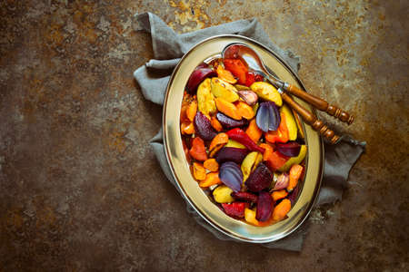 Roasted vegetables in a dish, simple vegetarian comforting side dish good for Thanksgiving dinner or any event, top view Stock Photo