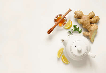 Ginger tea ingredients concept, healthy comforting and heating tea under simple recipe, view from above, space for a text Standard-Bild