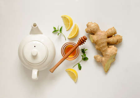 Ginger tea ingredients concept, healthy comforting and heating tea under simple recipe, view from above Standard-Bild