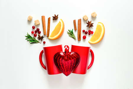 warmer: Winter warmer drink concept, two cups with warming alcohol cocktail recipe ingredients, winter holidays drink, flat lay, view from above