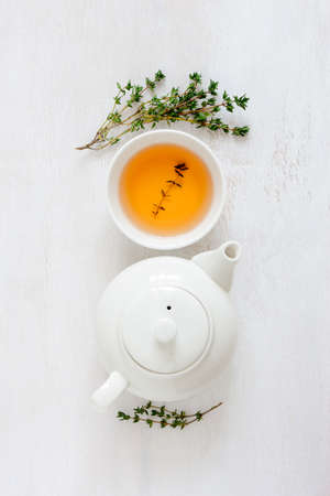 warming therapy: Thyme herbal tea, view from high angle, vertical orientation
