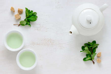 Fresh mint tea background with a space for a text, view from above