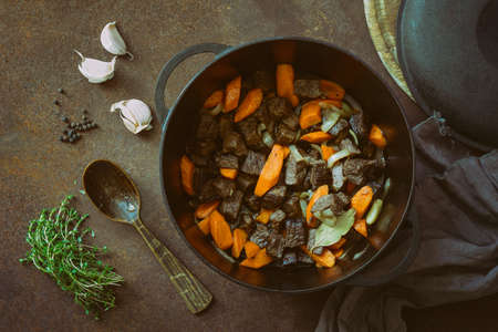 angle: Beef stew in a cast iron pan, view from above Stock Photo