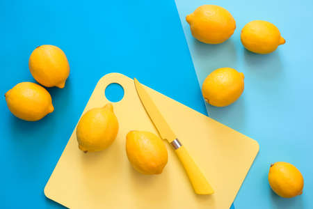 Lemons on a kitchen table, minimal cooking concept, view from above, space for a text Foto de archivo
