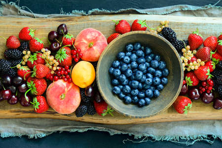 Various summer garden berries, view from above, flat lay Imagens