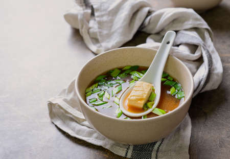 Traditional miso soup in a bowl, simply cooked tofu and miso sauce dish, rich source of vegan protein