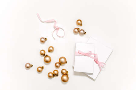 Festive Christmas gift concept with presents packed in white paper lying on white background, view from above 写真素材