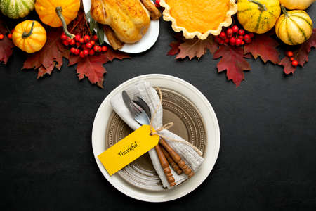 Thanksgiving table setting concept, overhead view on natural fall decor of festive dinner decoration idea