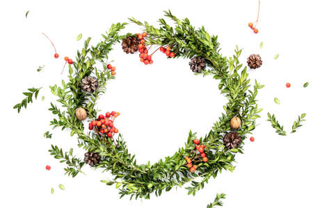 Christmas rustic wreath made of natural traditional winter holidays decor, Noel greeting card concept, flat lay arrangement with copy space for a greeting text