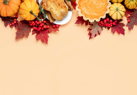 Thanksgiving Day concept, view from above on autumn natural foliage decor and traditional foods, festive dinner invitation background with blank space for a text 写真素材