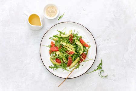 Detox grapefruit and arugula salad, top down view 写真素材