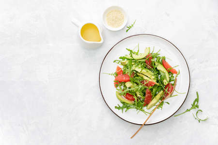 Detox grapefruit and arugula salad, top down view, copy space for a text