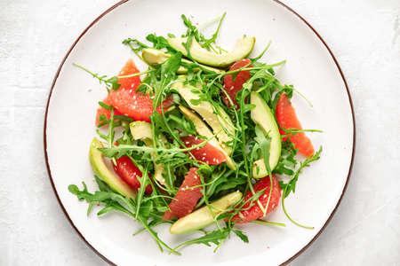 Detox grapefruit and arugula salad, top down close-up view