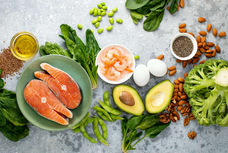 Omega 3 natural food sources concept, top down view of fresh food ingredients containing both plant or animal sources of Omega 3 Archivio Fotografico