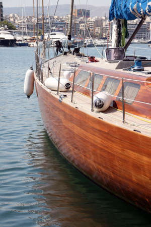 detail from luxurius wooden sailing yacht at marina  photo