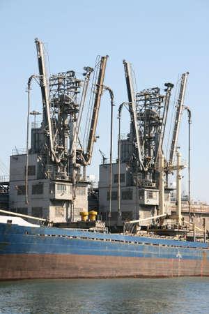 cargo ship loading equipment at piraeus greece 2 photo