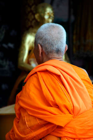 Buddhist monk in orange robe at big buddha temple samui island thailand