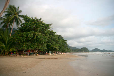 beach bars and people white sand beach koh chang island thailand photo