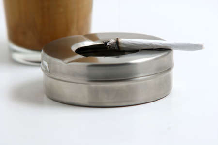 ashtray and cigaret with coffee backgroung photo