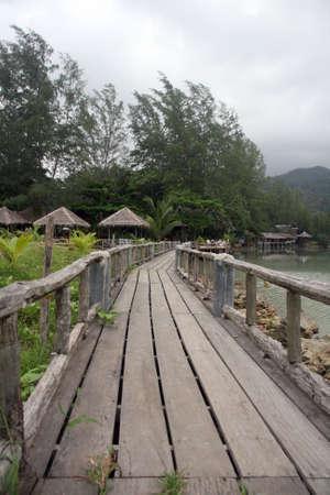 prespective: wooden bridge at blue lagoon koh chang island thailand