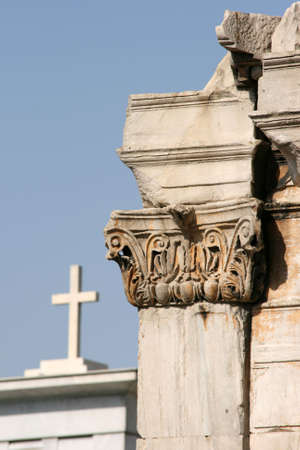 detail from Hadrians Arch with christian cross background  landmarks in Athens greece photo