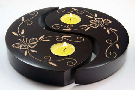 candes: wooden ying yang with candes on fire