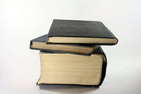 prespective: three old books closeup in white background prespective