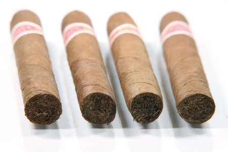 four cuban cigars in white background