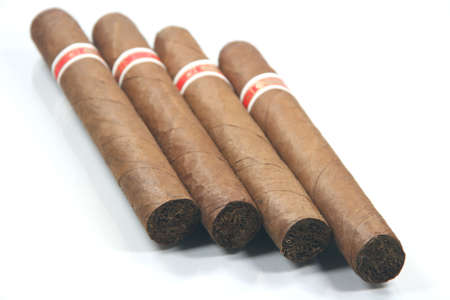 four cuban cigars in white background prespective